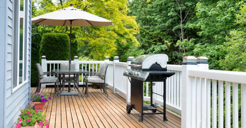 Backyard deck with table and umbrella